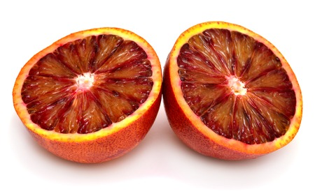 two and a half: Sicilian orange cut in half in two, isolated on white background