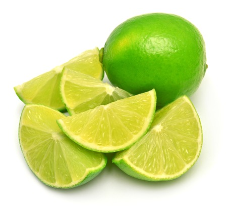 Limes and sliced limes isolated on white background