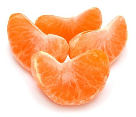 Slices of peeled tangerine isolated on white background