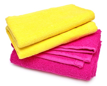 Two towels, yellow and pink towel isolated on white background