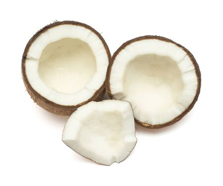 Coconuts two half and piece isolated on white background. Tropical fruit. Flat lay, top view Archivio Fotografico