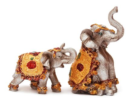 Two elephant family figurine isolated on white background 写真素材