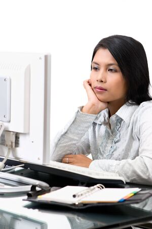 She look so boring looking at the LCD's screen and do nothing at workhour. Stock Photo - 3658873