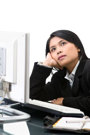 A business woman is thinking but her pose look like daydreaming in her office. Stock Photo - 3658866