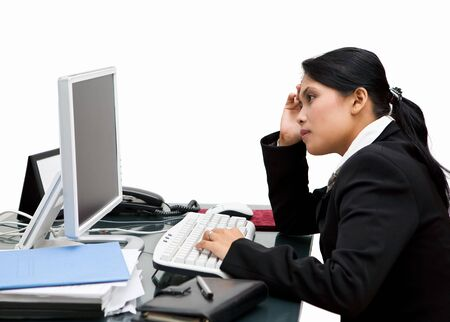The depressed and bored secretary in her office, holding his hand while looking at the screen Stock Photo - 3658871