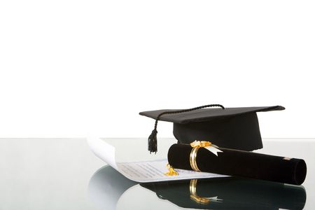 educational institution: Arranging my graduation thing on the desk against white background