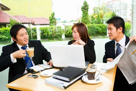 Situated in a café, a group of business people having light discussion spending their rest time. Stock Photo - 3658901