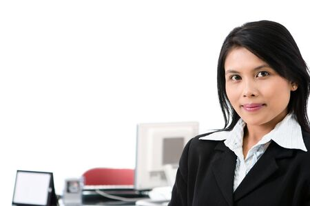 a female executive posing at her office in front of her working desk. Stock Photo - 3658861