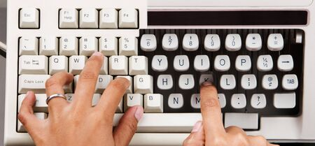 combining: an old keyboard and typewriter that has similar line width Stock Photo