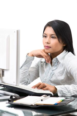 A woman employee work in elegant pose. Stock Photo - 3658874