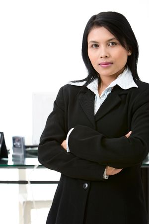 Situated in office, a business woman stand confidently in front of her working desk. Stock Photo - 3658878