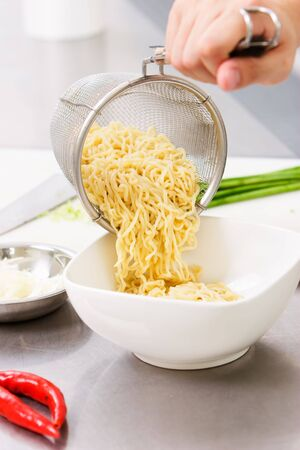 instant noodles: Observing how the chef make a wonton noodle in a cafe.