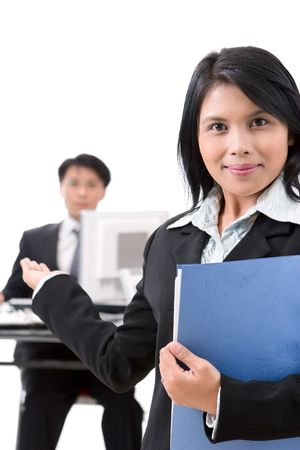 A woman employee welcoming a guest or a secretary welcoming a guest to meet the boss or even a businesswoman welcoming her partners to come in. It is up to your definition. Shoot against very bright background. Stock Photo - 3658877