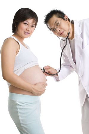 A doctor and the pregnant patient facing the camera. Shot against white background. photo