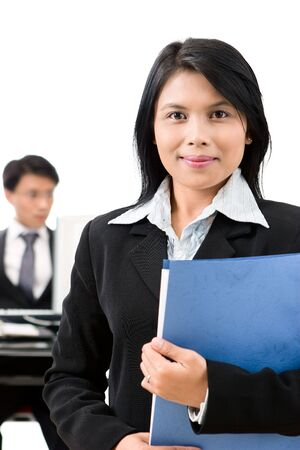 A business woman standing in front of her colleague in the office  Stock Photo - 3658976