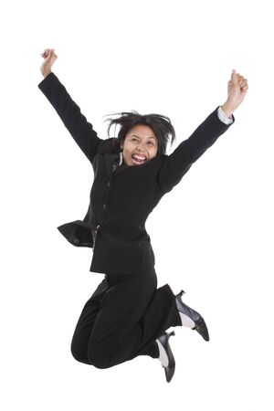 especially: A young businesswoman is jumping high and screaming happily. There is some movement blur in some part of her body, especially on the leg and hairs.