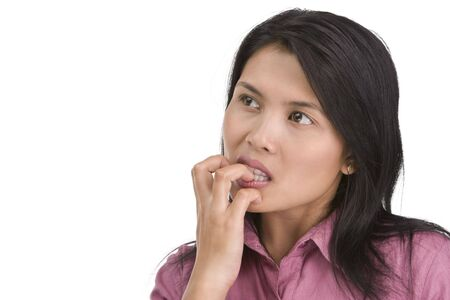 bad habit: A young woman is very nervous and have bad habit by biting her fingernail.