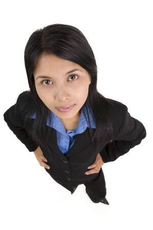 mani sui fianchi: Una giovane donna in affari akimbo pongono. Archivio Fotografico