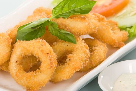 squids: Calamari with crispy floured or onion ring with crispy flour - deep fried.