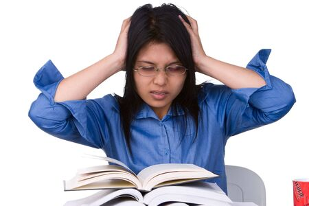 test deadline: A stressful female student facing a lot of books that she must read.