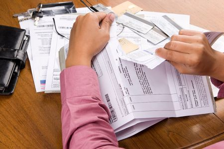 spendthrift: Tearing up all the bills and debt's invoice. The number and personal ID of the credit card has been removed or replaced from the original one to prevent unnecessary things. Stock Photo
