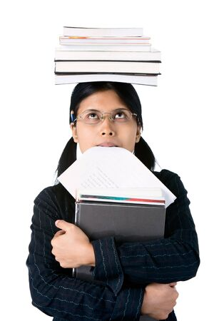 burden: Smart looking student gazing at the burden she must carry and bite her homework papers.