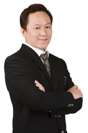 asian business man: A confident portrait of a young businessman against very bright white background