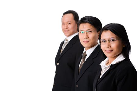 One bussinesswoman along the two businessman, focusing on the woman. Stock Photo - 3687064