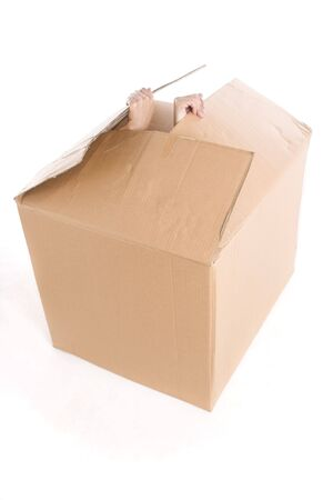 get out: Someone is trying to get out from the box. Stock Photo
