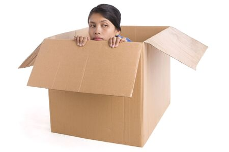 A young woman looks depressed inside the box. Stock Photo - 3802616