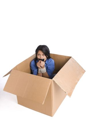 A young woman is afraid inside a box and her hand is tied up. Stock Photo - 3802605