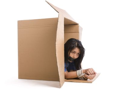 kidnapping: A young woman is trying to escape with her hand tied up. Stock Photo