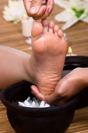 cleansed: The foot is being cleansed after massage. Stock Photo