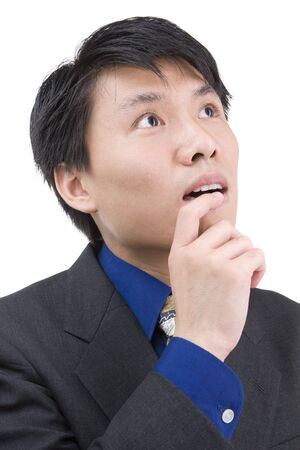 Young businessman is looking above looks like looking for an idea. Stock Photo - 3802663