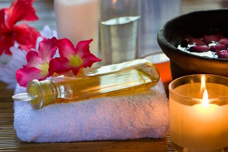 Arrange one of the essence oil above the towel used for reflexology in spa. photo