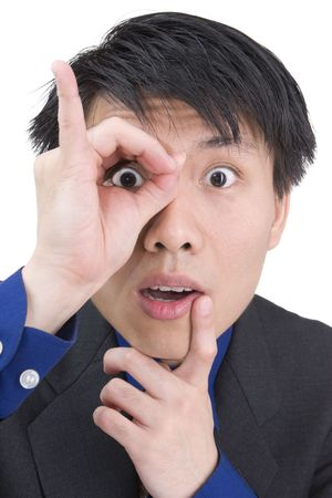 A young businessman is surprised while focusing his sight.