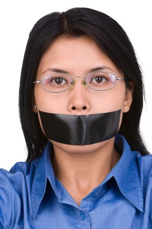 kidnapped: A young woman with her mouth plastered. Shoot against very bright white background to seperate it with the model naturally. Stock Photo