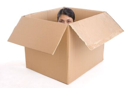 A young woman hiding inside a box, shot on white background Stock Photo - 3802624