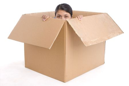A young woman is hiding her half face inside the box. Shot on white background.