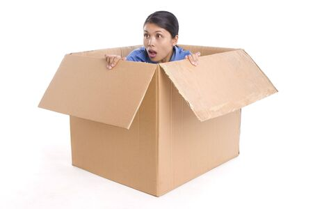 A young woman is surprised by something outside the box. Shot against white Stock Photo - 3802618
