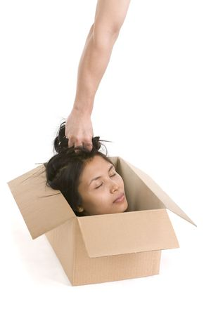 death head holding: A woman whose face express peace inside th box while a hand holding her hair.