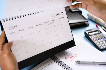 january calendar: Flipping the calendar to January 2009. Focus on the word Planning on the book. Stock Photo