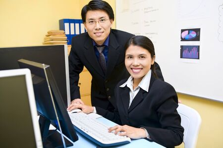 Happy businessman and businesswoman is smiling and facing the camera. photo