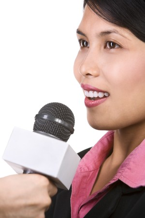 interviewed: A young businesswoman is being interviewed, shot aginst white background. Focus mainly on womans mouth