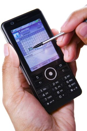 stylus: A hand using stylus on touch screen of a PDA phone. Stock Photo