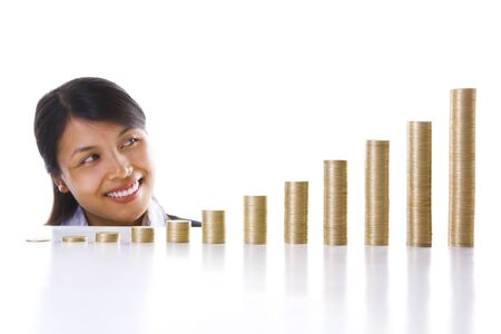 exponential: A young Asian businesswoman looking at her investment growing showing by higher stack of coins to the right side (represent time line in a year). Main focus on coin stacks.