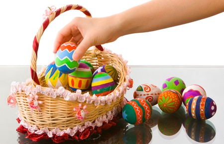 Use some Easter eggs that have been colored by elementary school�s student and arranging them in a nice basket photo
