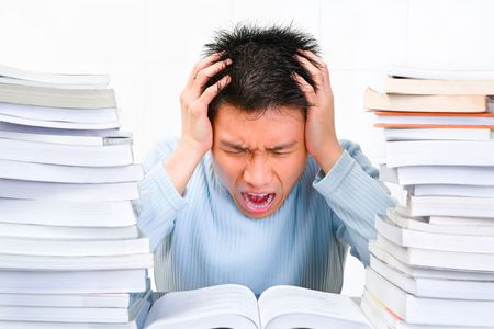 scholars: A young scholar is screaming stressfully while studying