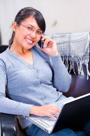 Portrait of a young Asian woman talking on the phone and facing camera. Stock Photo - 4592133