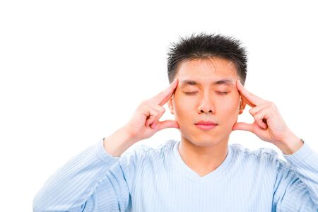 eyes shut: A young man is trying to imagine  concentrate with his eyes shut Stock Photo